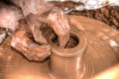 Hands. Of a potter shaping a vase on a potters wheel Stock Photos