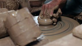 Hands of potter, was produced on range of pot. stock footage