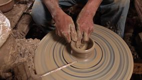 Hands of potter, was produced on range of pot. stock video footage