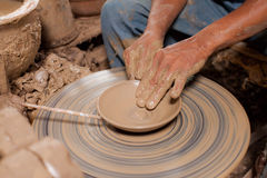 Hands of potter, was produced on range of pot. Royalty Free Stock Images