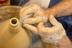 Hands of potter at work Stock Photo