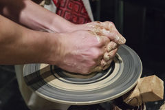 Hands of a potter at work. Handmade pottery on a potter's wheel Stock Photography