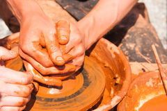 Hands of potter at work Royalty Free Stock Images