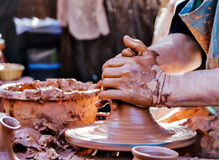 Hands of a potter. Potter working at a medieval fair, creating a jar Stock Photography