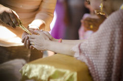 Hands pouring blessing water into bride's bands, Thai wedding ce Royalty Free Stock Image