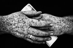 Hands and poverty. Money in the hands of a poor woman Royalty Free Stock Photos