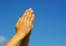 Hands in prayer Stock Image