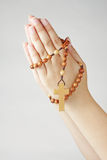 Hands  in prayer with a rosary. Hand closed in prayer with a rosary Stock Photography