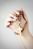 Hands  in prayer with a rosary. Hand closed in prayer with a rosary, vignette added Royalty Free Stock Photography