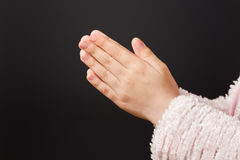 Hands Praying. A close up of a young girl`s hands while praying royalty free stock image