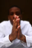 Hands Praying, Intentional blur Stock Photo