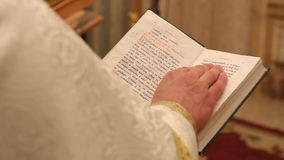 Hands of praying priest on the Bible 1080p Royalty Free Stock Photo