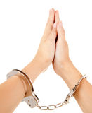 Hands of praying woman with handcuffs Stock Image