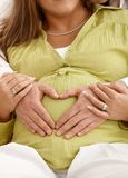 Hands on pregnant belly Stock Photos