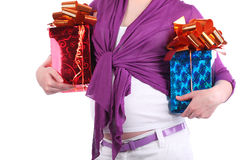 Hands of pregnant woman holding boxes with gift stock photo