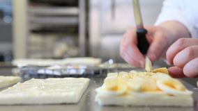 Hands prepare eggs and asparagus sandwich stock footage