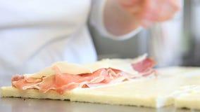 Hands prepare ham and cheese sandwich stock video