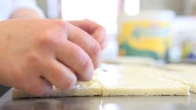 Hands prepare ham and cheese sandwich stock footage