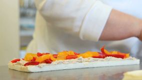 Hands prepare a sandwich with peppers stock footage