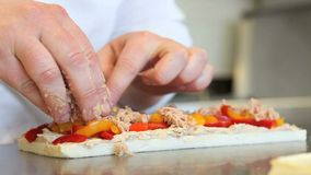 Hands prepare a sandwich with peppers and tuna. Chef hands prepare a sandwich with peppers and tuna stock video footage