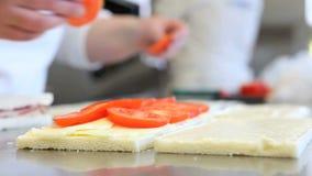 Hands prepare sandwich with tomato mozzarella stock video footage