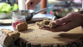 Hands prepare sandwiches. stock footage