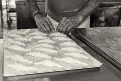 Hands preparing french croissant in black and white Royalty Free Stock Photo