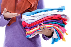 Hands presenting clean and tidy folded clothes after ironing Royalty Free Stock Photography