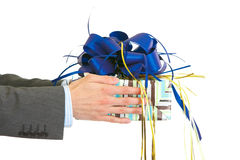 Hands presenting gift Royalty Free Stock Image