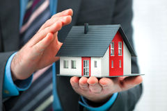 Hands presenting a small house Stock Photography