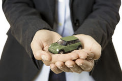 Hands presenting a toy car Stock Photos