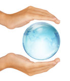 Hands Preserving Half Earth Globe Isolated Royalty Free Stock Photography
