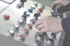 Hands pressing buttons on the control panel. Close-up. operator`s work at the control panel stock photo
