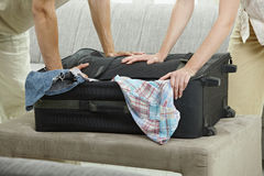 Hands pressing suitcase Stock Photography
