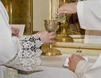 Hands of priest by the mass Royalty Free Stock Images