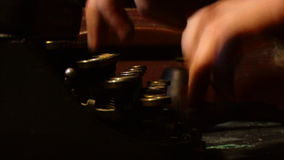 Hands print on printed typewriter. Macro stock video