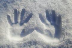 Hands print on snowflake Stock Photos