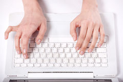Hands print the text on  keyboard Stock Images