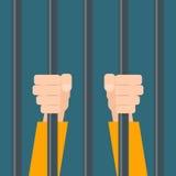 Hands of prisoner behind bars. Stock Images