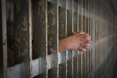 Hands of Prisoner Coming from Cell Royalty Free Stock Image