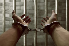 Hands of prisoner. In handcuffs Royalty Free Stock Photos