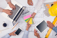 Hands of professional architects discussing and working with blu Royalty Free Stock Photo