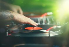 hip hop dj scratches vinyl records with music stock images