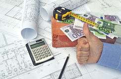 Hands and project drawings Royalty Free Stock Photos