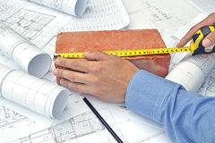 Hands and project drawings Royalty Free Stock Images