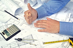 Hands and project drawings Stock Images
