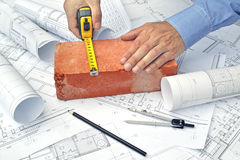 Hands and project drawings Stock Photo