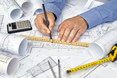 Hands and project drawings Royalty Free Stock Image