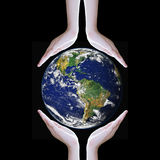 Hands protect earth ,Elements of this image furnished by NASA Stock Images