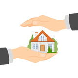 Hands protect home. Concept of house insurance, protection and safety. Insurance agency Royalty Free Stock Photos